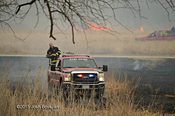 firemen fight a grass fire