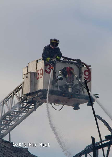 fireman working from tower ladder