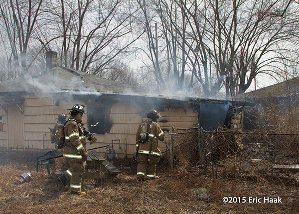 firemen at vacant house fire