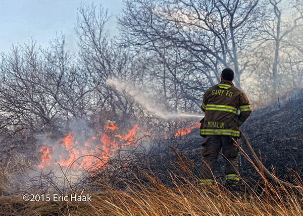 fireman fights brush fire