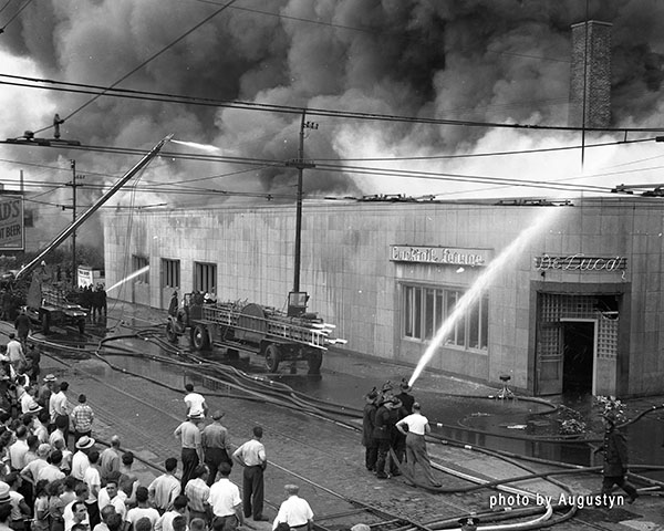 antique fire trucks at 1950s era Chicago fire scene