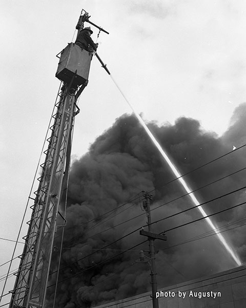 water tower at work during 1950s era fire in Chicago