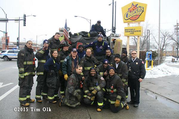 firemen pose for group shot after battling a fire