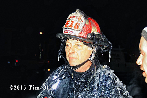 fireman covered with ice at winter fire scene