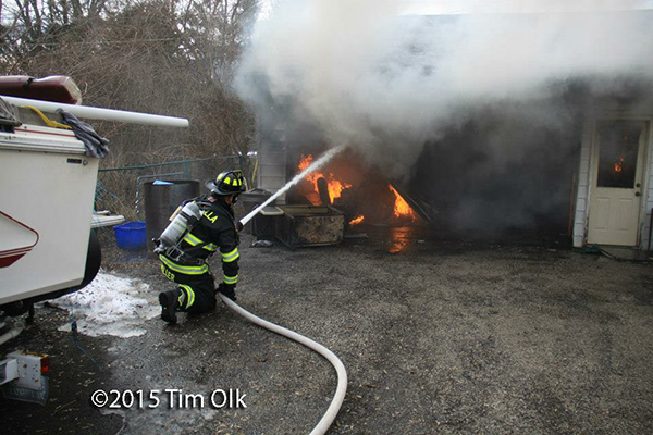 fireman fights garage fire