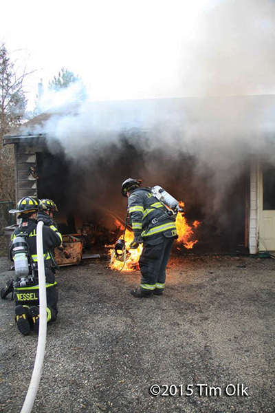 firemen fight garage fire