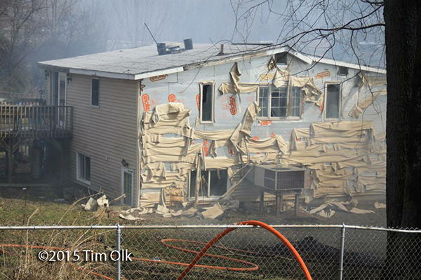 house damaged by radiant heat of fire next door