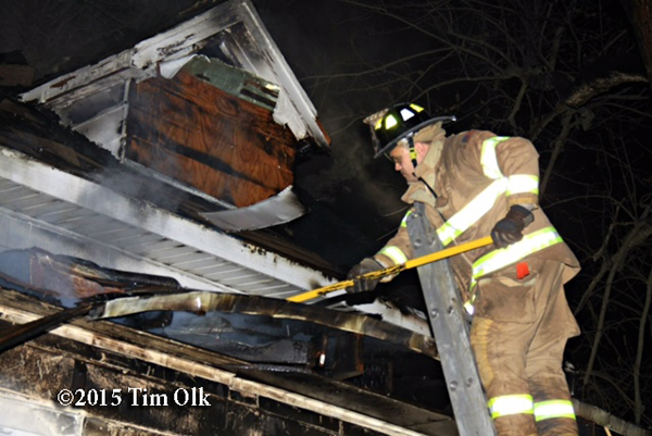fireman overhauls after house fire