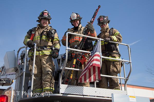 firemen posing at fire scene