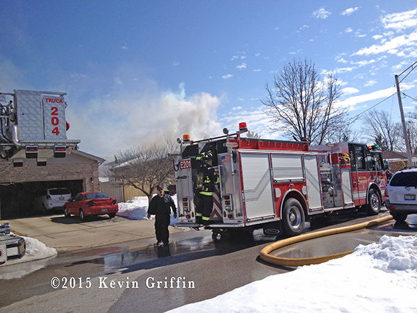 Firemen in Tinley Park (IL) at the scene of a house fire 3/7/15