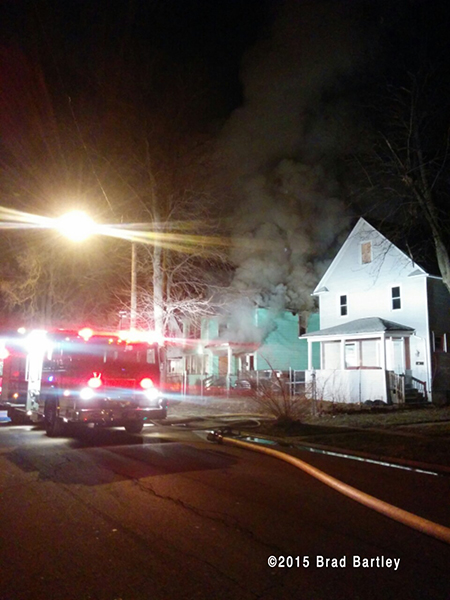 house engulfed in smoke at night