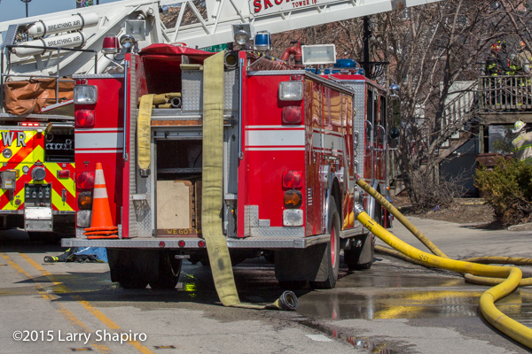 fire engine with hose off at fire scene