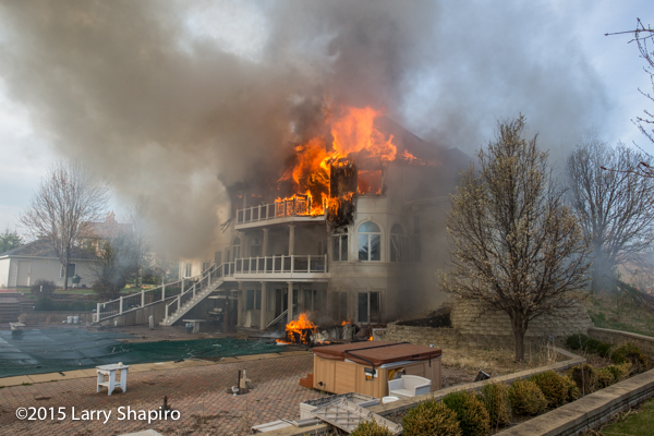 mega mansion engulfed in flames