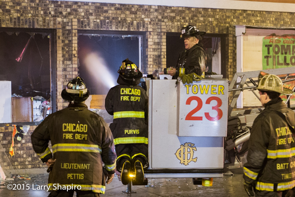 Chicago FD Tower Ladder 23 working at a fire
