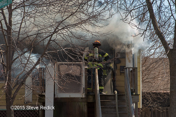 firemen battle house fire