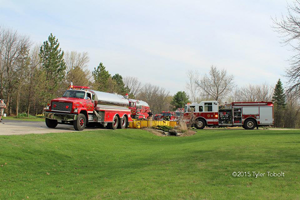 fire department water tenders filling portable tanks