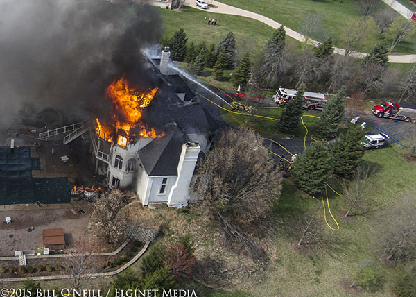 drone footage of mega mansion engulfed in flames