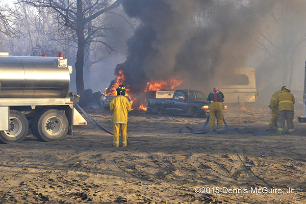 cars destroyed by brush fire