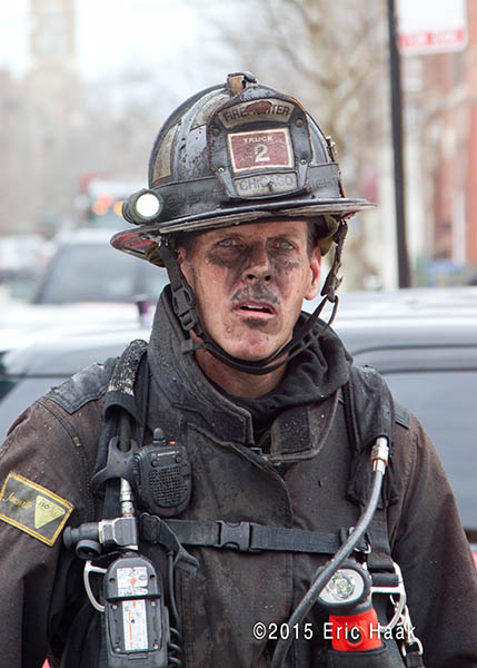 fireman with dirty face after fighting a fire