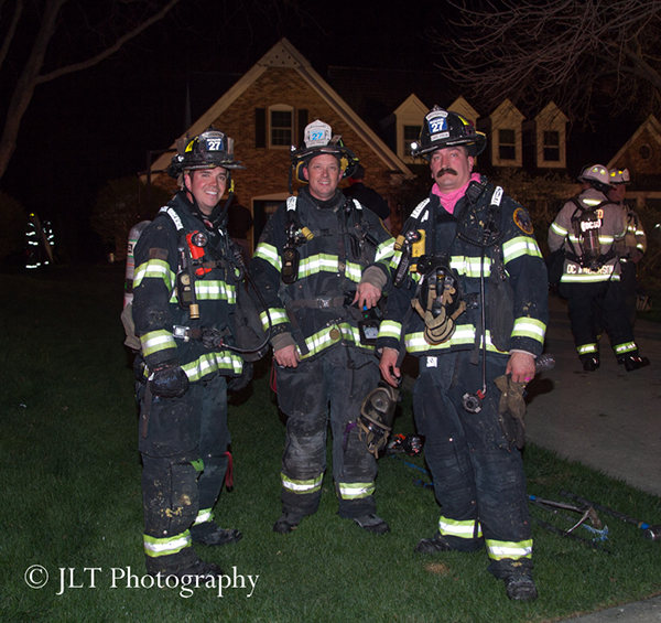 firemen at night fire scene