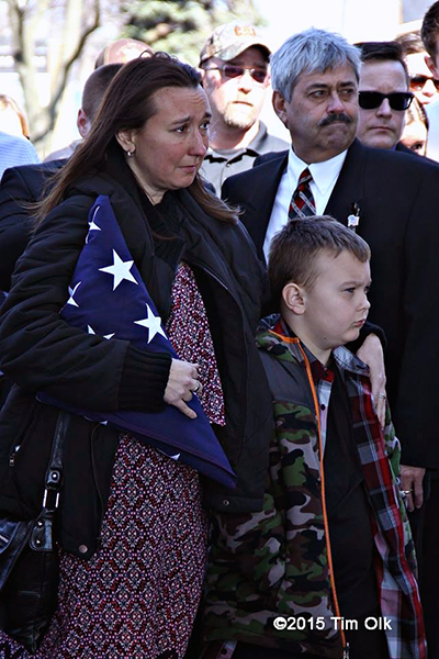 wife and son of a firefighter at his funeral