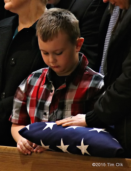 son of a firefighter at his funeral