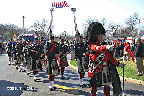 fire department bagpipers at firefighter funeral