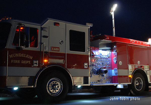 fire engine at night with light tower