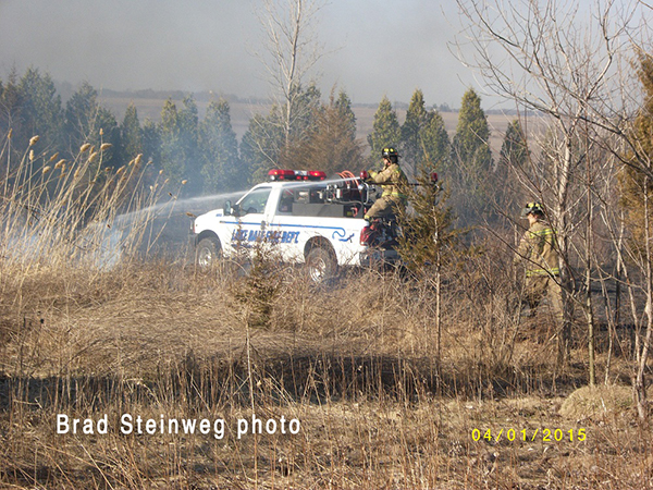 fire department uses brush truck on grass fire