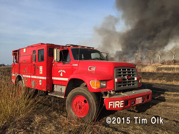 wild land crew carrier engine at fire scene