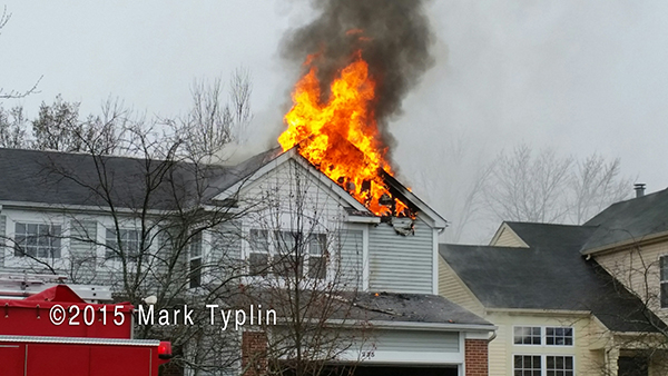flames through roof of house struck by lightning