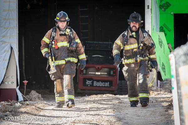 firemen after battling a fire