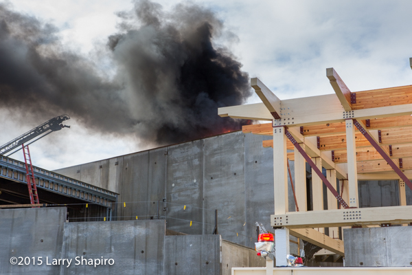 heavy smoke from roof at construction site