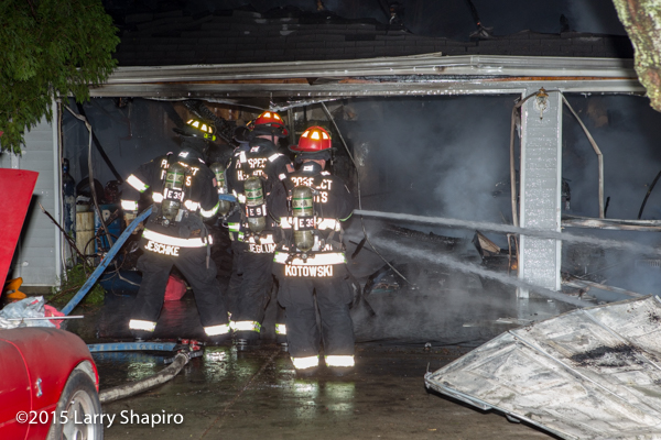 firemen fight a garage fire