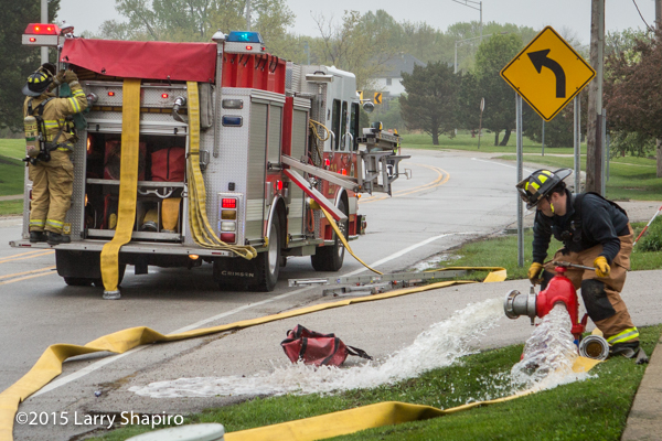 fireman flushes hydrant at fire scene