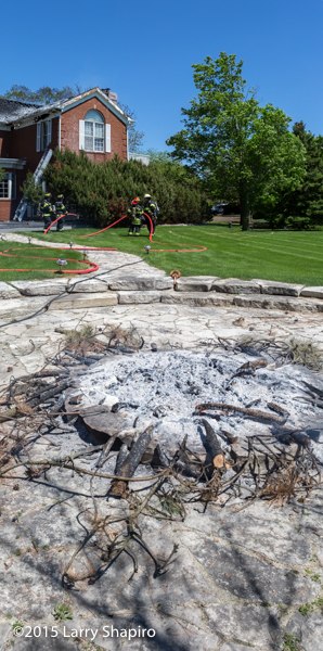 smoldering fire pit at house fire
