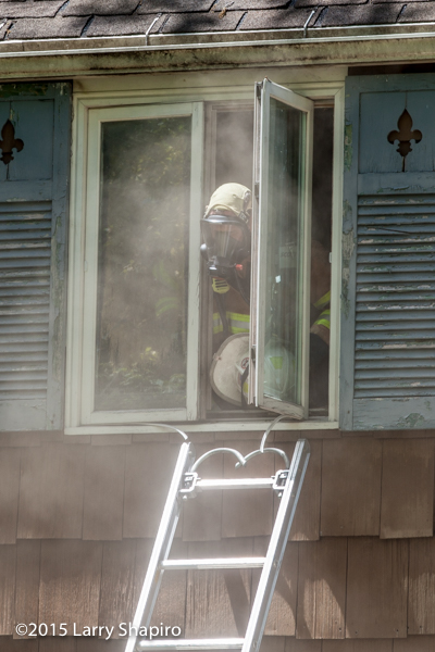 fireman surrounded by smoke at window