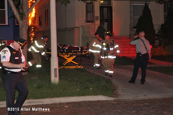 injured victim from house fire on gurney
