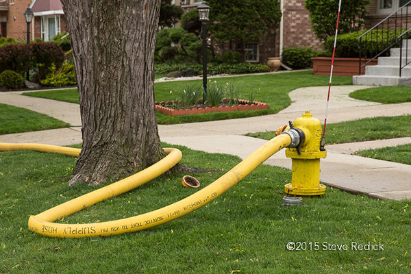 hose attached to fire hydrant
