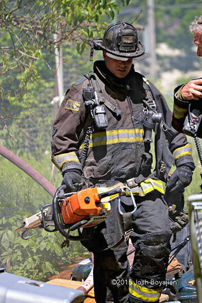fireman carrying tools after a fire
