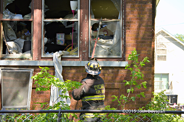 fireman overhauls house after a fire