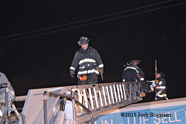 fireman walking down aerial ladder