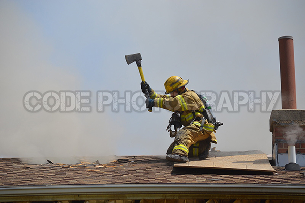 fireman on roof with axe