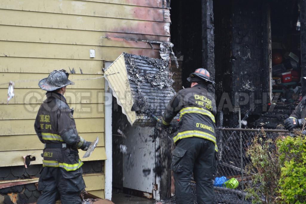 firemen overhaul house after fire