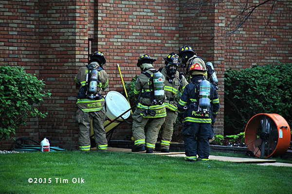 firemen remove hazardous chemical from building
