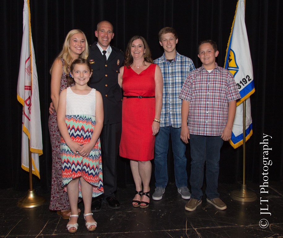FD battalion chief with his family after being promoted