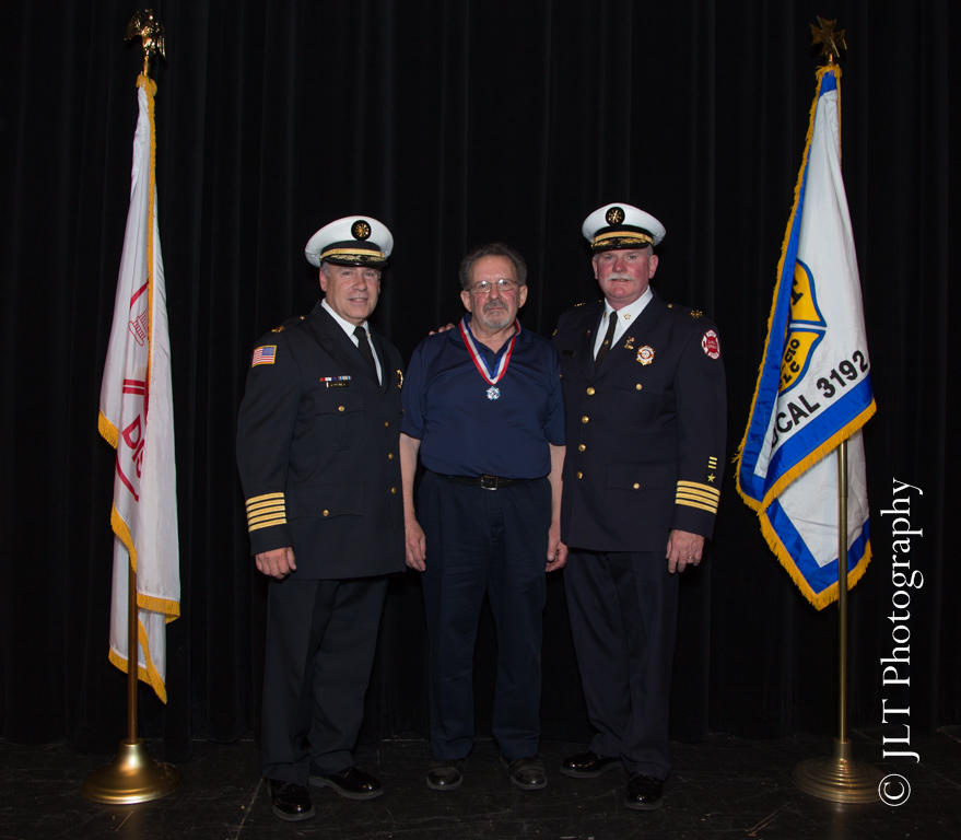 Carol Stream Fire District award recipient with chief officers