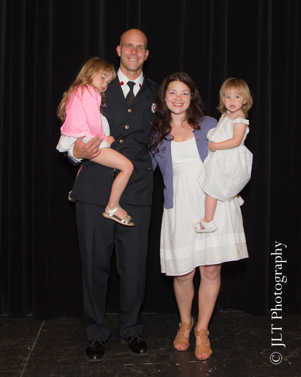 FD lieutenant with his family after being promoted