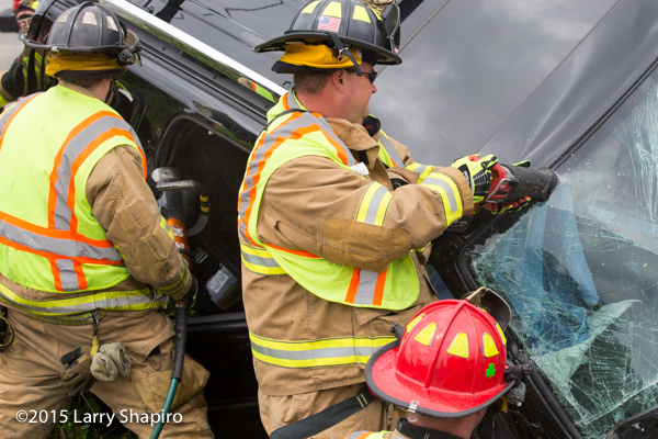 fireman uses sawzall to cut windshield
