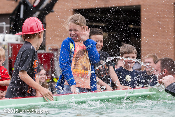kids having fun during a demonstration of a fire department diver